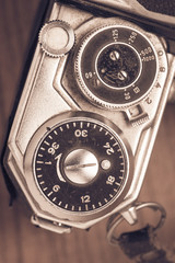 Close up of old fashioned retro camera in vintage style