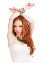 Beautiful redheaded girl with green jewelry