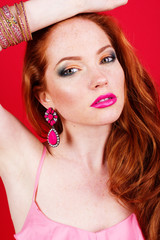 Beautiful redheaded girl with pink jewelry