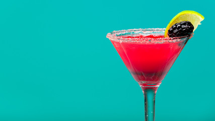 Fruit cocktail on pastel turquoise background