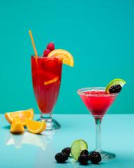 Fruit cocktails on pastel turquoise background