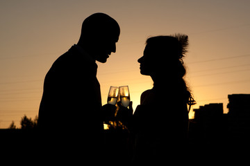 Silhouette of wedding couple at sunset