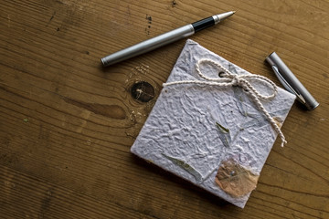 Old diary memories with pen on a wooden table 2