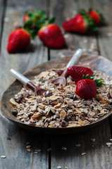 Homemade muesli with strawberry on the wooden table