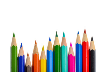 Front view of aligned coloring crayons isolated in white