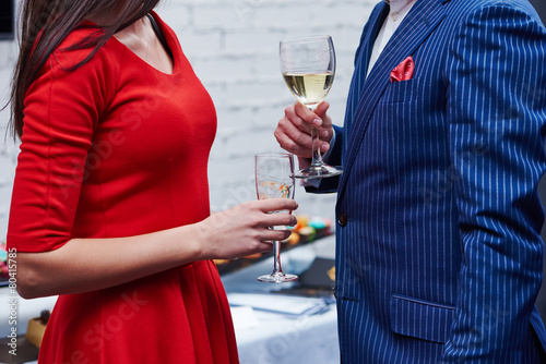 Canvas Buffet, Bar man and woman with glasses of wine at party