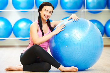 female instructor portrait with fitness ball