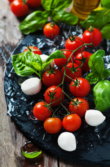 Fresh tomatoes, mozzarella and green basil