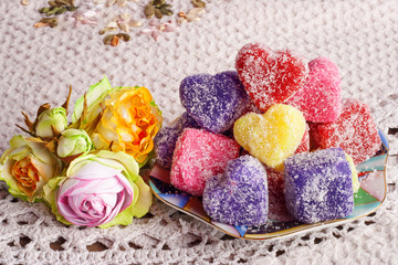colored soap in the form of heart on a white tablecloth