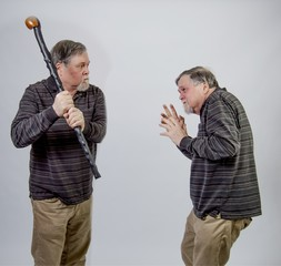 One twin senior about to strike the other with his cane