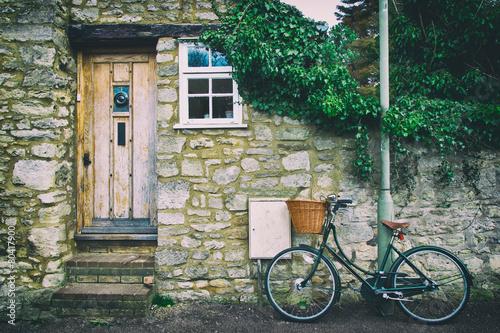 Leinwandbild Motiv English front cottage with bicycle