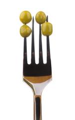 Green peas skewered on fork