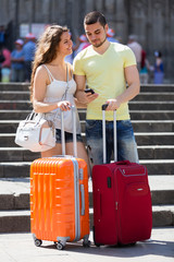 Nice young travellers finding path with smartphone