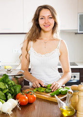 woman in apron at home kitchen