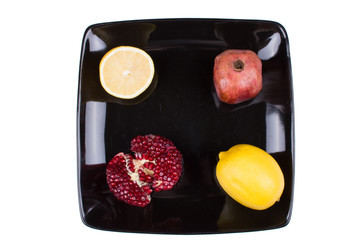 Fruit plate with oranges, apples, lemon