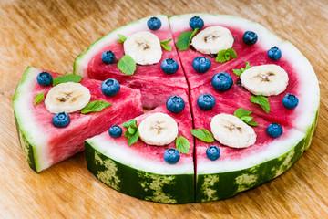Watermelon pizza on wood