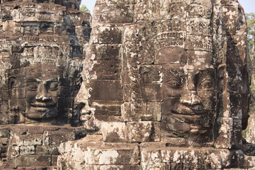 Four sides stone faces of Bayon temple in Angkor