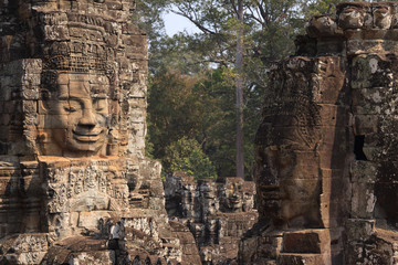 Stone faces in Bayon temple in ancient city Angkor