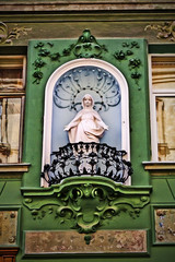 sculpture of a woman on the front of the house