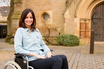 young woman in a wheelchair outside a church