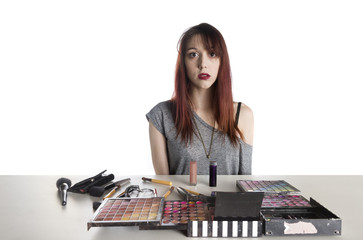 Young Woman with Large Palette of Make Up