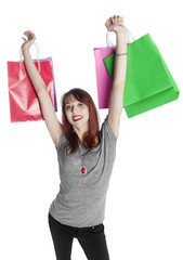 Young Woman Holding Up Colorful Shopping Bags