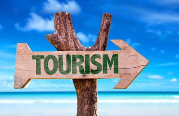 Tourism sign with a beach on background