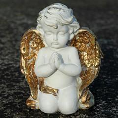 praying angelic little figurine