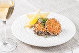 Fish cutlets breaded in sesame. Salmon burgers