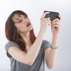 Seductive Young Woman Taking Selfie Photo on Phone