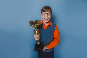 European-looking  boy of  ten years in glasses holding a cup