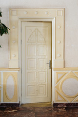 Beautiful carved white door in the hotel