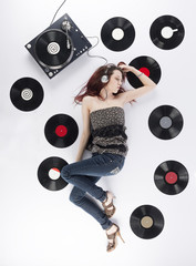 Young Woman Resting on the Floor Listening Music