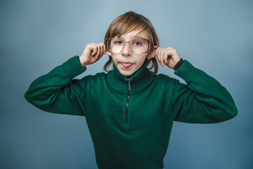 European-looking  boy  of  ten years shows  tongue teases on a