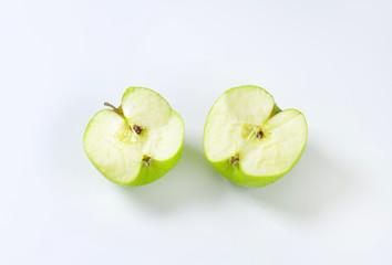 Halved green apple