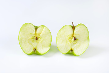 Halved green apple