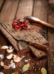Old wooden board wih dried pepper