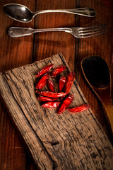 Red dried pepper on rustic board