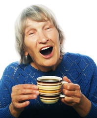 Happy old lady with coffee