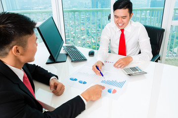 Asian banker counseling financial investment