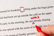 Red Pen Proofreading a Manuscript by Laptop - 80427783