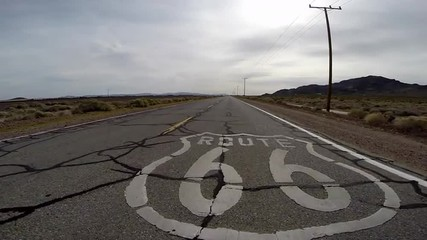 Route 66 Pavement Sign Driving Shot