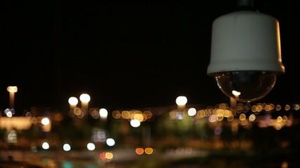cctv security camera watching city at night