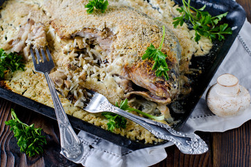 Carp stuffed with rice and mushrooms baked in sour cream
