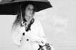 Beautiful fashion woman with umbrella in the rain