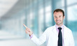 happy male doctor smiling pointing with finger away up