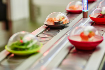 Sushi plates on rails in restaurant