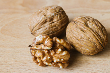 walnuts and kernel on wooden background