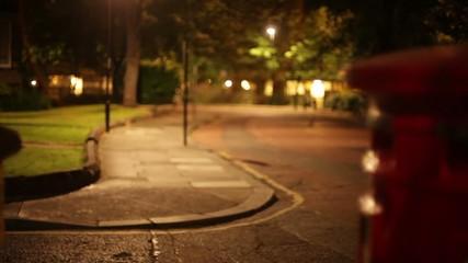 slider footage of red uk royal mail pillar box at night