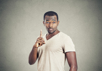 Man pointing up having idea solution, showing finger number one